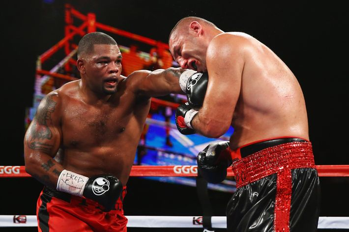 Mike Perez punches  Magomed Abdusalamov during their Heavyweight fight at The Theater at Madison Square Garden on November 2, 2013 in New York City.