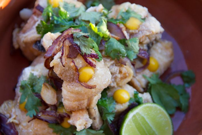 Chicken chicharrones with garlic, red onions, herbs, and lime.