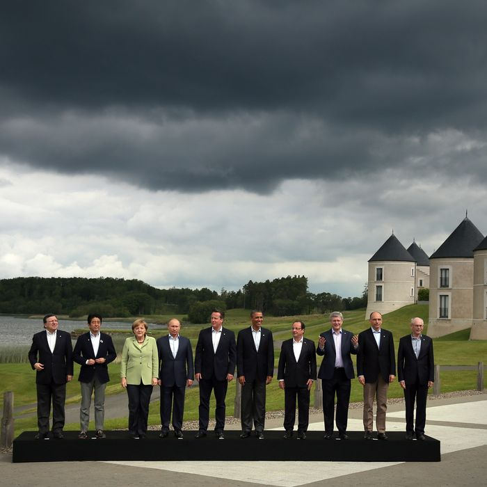 ENNISKILLEN, NORTHERN IRELAND - JUNE 18: (L-R) President of the European Commission Jose Manuel Barroso, Japanese Prime Minister Shinzo Abe, German Chancellor Angela Merkel, Russia's President Vladimir Putin, Britain's Prime Minister David Cameron, US President Barack Obama, French President Francois Hollande, Canadian Prime Minister Stephen Harper, Italian Prime Minister Enrico Letta and European Council President Herman Van Rumpuy, arrive for the 'family' group photograph at the G8 venue of Lough Erne on June 18, 2013 in Enniskillen, Northern Ireland. The two day G8 summit, hosted by UK Prime Minister David Cameron, is being held in Northern Ireland for the first time. Leaders from the G8 nations have gathered to discuss numerous topics with the situation in Syria expected to dominate the talks. (Photo by Matt Cardy/Getty Images)