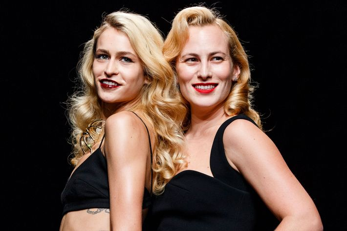 Sisters Alice Dellal and Charlotte Dellal walk the Charlotte Olympia runway.