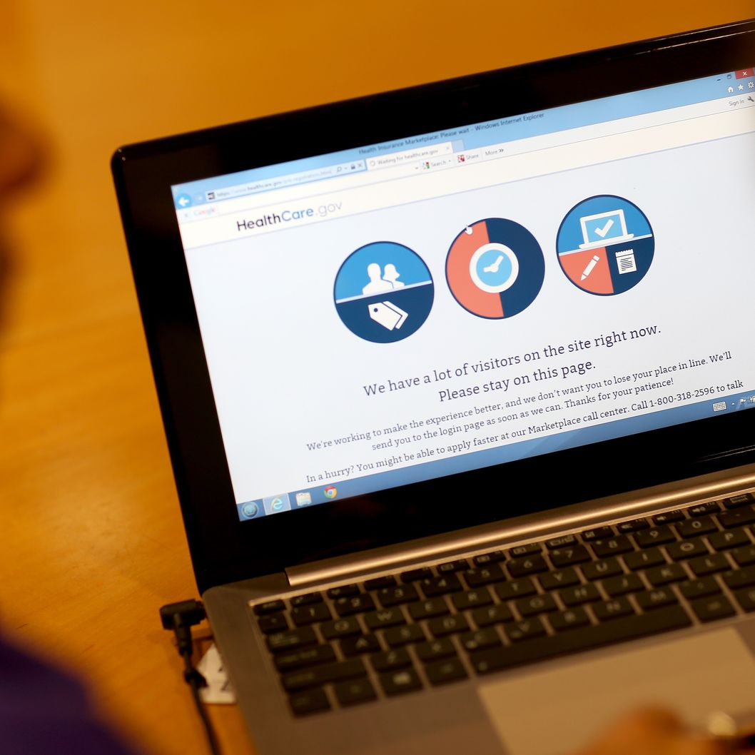 MIAMI, FL - OCTOBER 08: A message is seen on the computer indicating that there are too many visitors on the Affordable Care Act site to continue, as navigator Nini Hadwen helps people shop for health insurance during a navigation session put on by the Epilepsy Foundation Florida to help people sign up for health insurance under the Affordable Care Act on October 8, 2013 in Miami, Florida. The United States government continues to be partially shut down as Republicans hold out hope to cut funding for the Affordable Care Act.  (Photo by Joe Raedle/Getty Images)