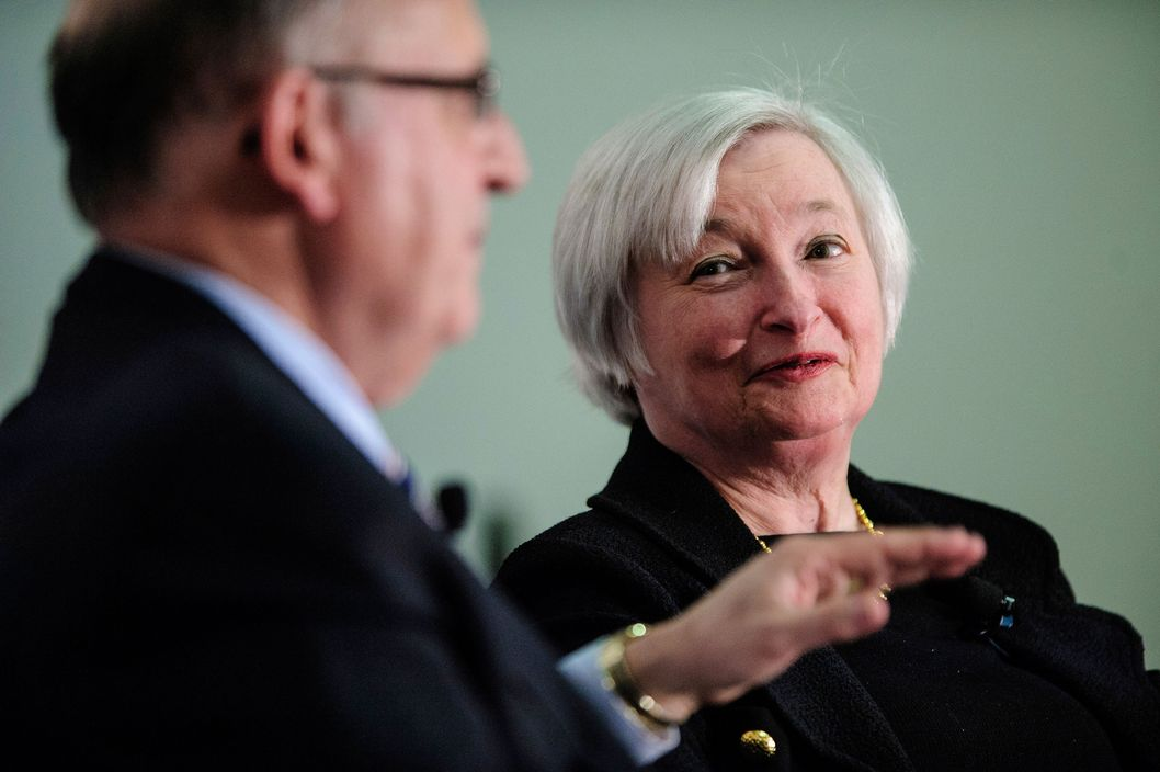 Janet Yellen, vice chairman of the U.S. Federal Reserve, right, speaks while Allan Sloan, senior editor of Fortune Magazine, listens at the Society of American Business Editors and Writers (SABEW) 2013 Spring Conference in Washington, D.C., U.S., on Thursday, April 4, 2013. Yellen said the Federal Open Market Committee should be prepared to alter its $85 billion monthly pace of bond buying based on changes in the economic outlook.