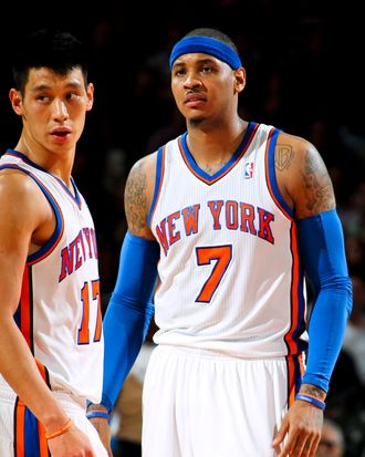 Jeremy Lin #17 and Carmelo Anthony #7 of the New York Knicks play against the New Jersey Nets