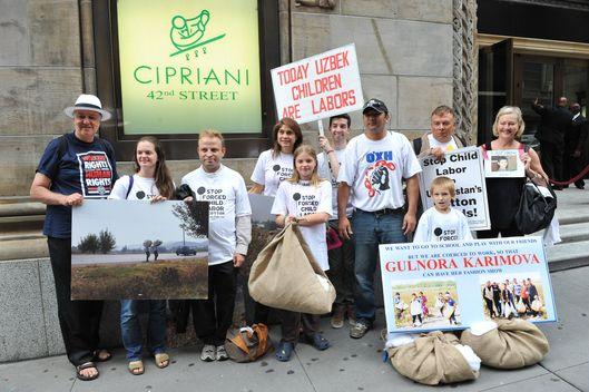 NEW YORK, NY - SEPTEMBER 15:  Protestors demonstrate against child labor outside the Guli Spring 2012 fashion show at Cipriani 42nd Street on September 15, 2011 in New York City.  (Photo by Marc Stamas/Getty Images)