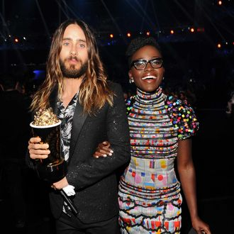 LOS ANGELES, CA - APRIL 13: Actor Jared Leto (L), winner of the Best On-Screen Transformation award for 'Dallas Buyers Club,' and actress Lupita Nyong'o attend the 2014 MTV Movie Awards at Nokia Theatre L.A. Live on April 13, 2014 in Los Angeles, California. (Photo by Kevin Mazur/WireImage)