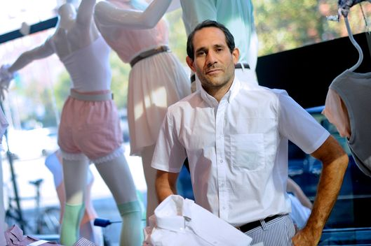 Dov Charney, chairman and chief executive officer of American Apparel Inc., stands for a portrait in a company retail store in New York, U.S., on Thursday, July 29, 2010. Starting the company in a dorm at Tufts University in Medford, Massachusetts, Charney built a worldwide empire of 280 clothing stores by leaping out ahead of mainstream fashion. He personified the racy, risk-taking aesthetics of his business and is now facing the consequences - skittish lenders and investors who doubt his ability to oversee his own creation. Photographer: Keith Bedford/Bloomberg via Getty Images *** Local Caption *** Dov Charney