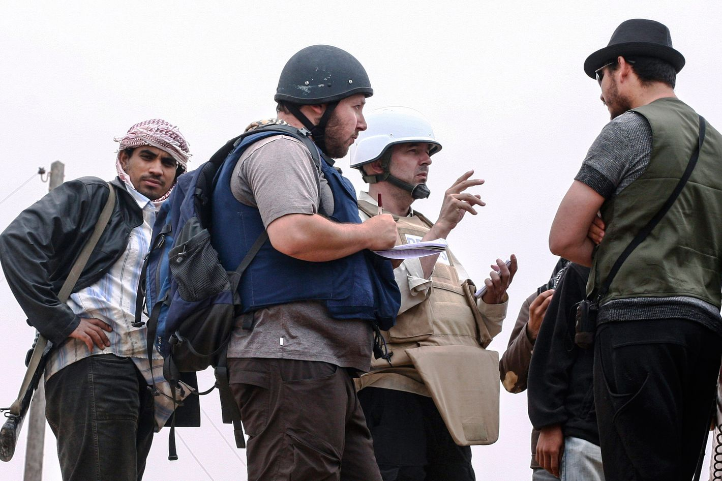 In this handout image made available by the photographer American journalist Steven Sotloff (Center with black helmet) talks to Libyan rebels on the Al Dafniya front line, 25 km west of Misrata on June 02, 2011 in Misrata, Libya.