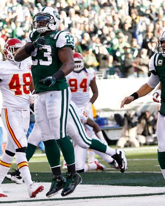 Shonn Greene #23 and Mark Sanchez #6 of the New York Jets celebrates a touchdown during their game against the Kansas City Chiefs at MetLife Stadium on December 11, 2011 in East Rutherford, New Jersey.