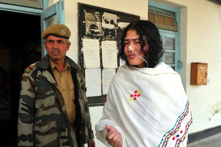 "TO GO WITH India-unrest-Manipur-politics,FEATURE by Abhaya Srivastava  A policewoman escorts civil rights activist, Irom Sharmila Chanu (R) also known as the ""Iron Lady of Manipur"" or ""Mengoubi"" (meaning ""the fair one"") to an ambulance as she leaves The Magistrate's Court in Imphal on February 22, 2012.  For more than 11 years, Sharmila has refused food and water to back her demand for the withdrawal of the special powers wielded by -- and according to critics widely abused by -- the security forces."