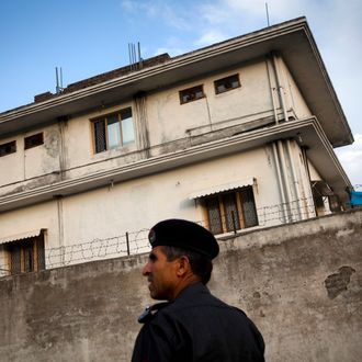 ABBOTTABAD, PAKISTAN - MAY 4: A Pakistani policeman stands outside the compound where Osama Bin Laden was killed in an operation by US Navy Seals, on May 4, 2011, in Abottabad, Pakistan. Bin Laden was killed during a U.S. military mission on May 2, at the compound. The Obama administration have decided not to release photographs of Bin Laden's body. (Photo by Warrick Page/Getty Images)
