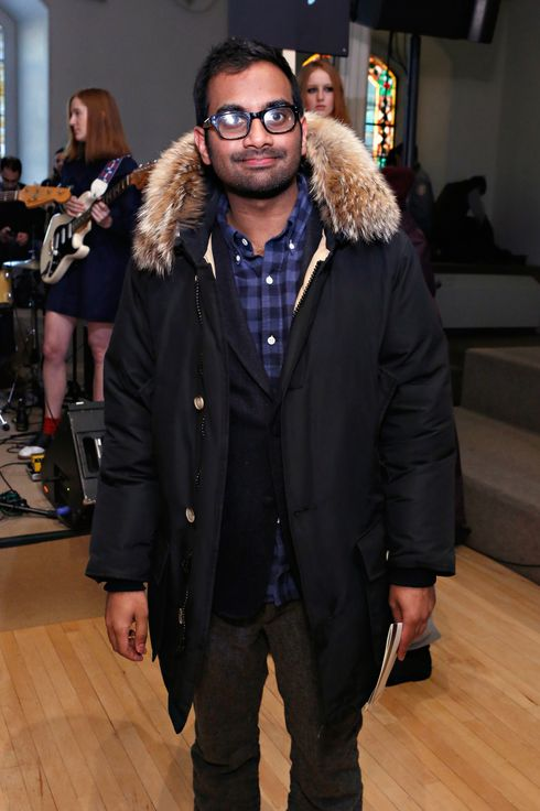 Comedian/ actor Aziz Ansari attends the Chloe Sevigny for Opening Ceremony fall 2013 fashion show during Mercedes-Benz Fashion Week at St. Mark's Church In The Bowery on February 9, 2013 in New York City.