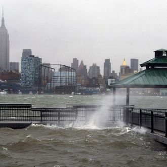 The New York City skyline and Hudson River are seen from Hoboken, NJ as Hurricane Sandy approaches on Monday, Oct. 29, 2012. Hurricane Sandy continued on its path Monday, as the storm forced the shutdown of mass transit, schools and financial markets, sending coastal residents fleeing, and threatening a dangerous mix of high winds and soaking rain. (AP Photo/Charles Sykes)