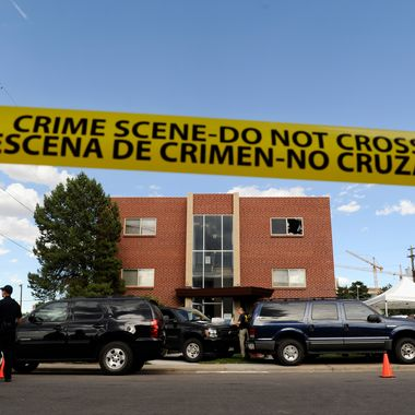 AURORA, CO -  JULY 21:  Police surround the apartment of James Holmes, the suspect in the Colorado theater shooting, on July 21, 2012 in Aurora, Colorado. Numerous explosive devices were found in the apartment and successfully disarmed. According to reports, 12 people have been killed and over 59 injured including 9 in critical condition. (Photo by Chris Schneider/Getty Images)