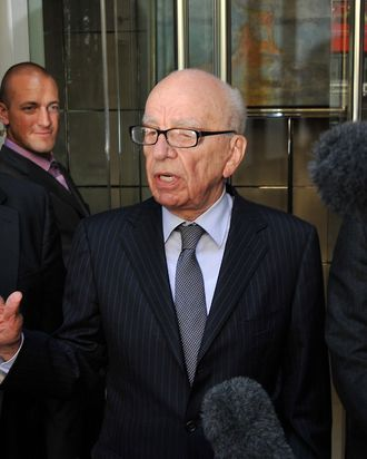 News Corporation Chief Rupert Murdoch (C) speaks to the media after meeting the family of murdered British school girl Milly Dowler in London, on July 15, 2011. Rupert Murdoch will use advertisements in British national newspapers on Saturday to apologise for