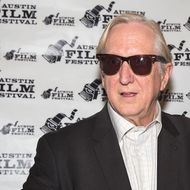 AUSTIN, TX - OCTOBER 28:  Music producer T-Bone Burnett arrives at the premiere of 'Inside Llewyn Davis' during the Austin Film Festival at The Paramount Theatre on October 28, 2013 in Austin, Texas.  (Photo by Rick Kern/Getty Images)