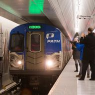 NEW YORK, NY - FEBRUARY 25: The first PATH train arrives at the opening of a new platform for the New Jersey PATH Train at the World Trade Center, on February 25, 2014 in New York City. The platform will primarily service PATH trains from Hoboken, NJ, to New York, NY - it is expected to service 100,000 riders a day. (Photo by Andrew Burton/Getty Images)