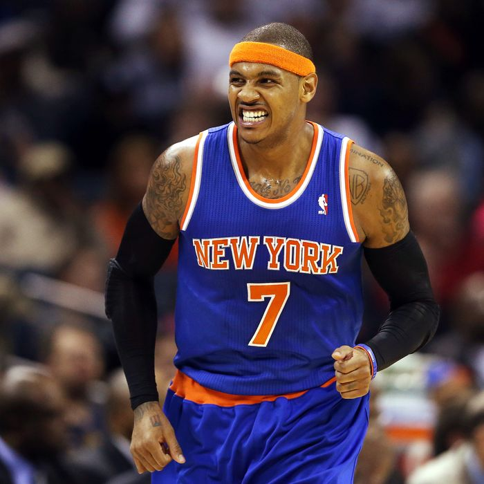 Carmelo Anthony #7 of the New York Knicks reacts after making a basket.