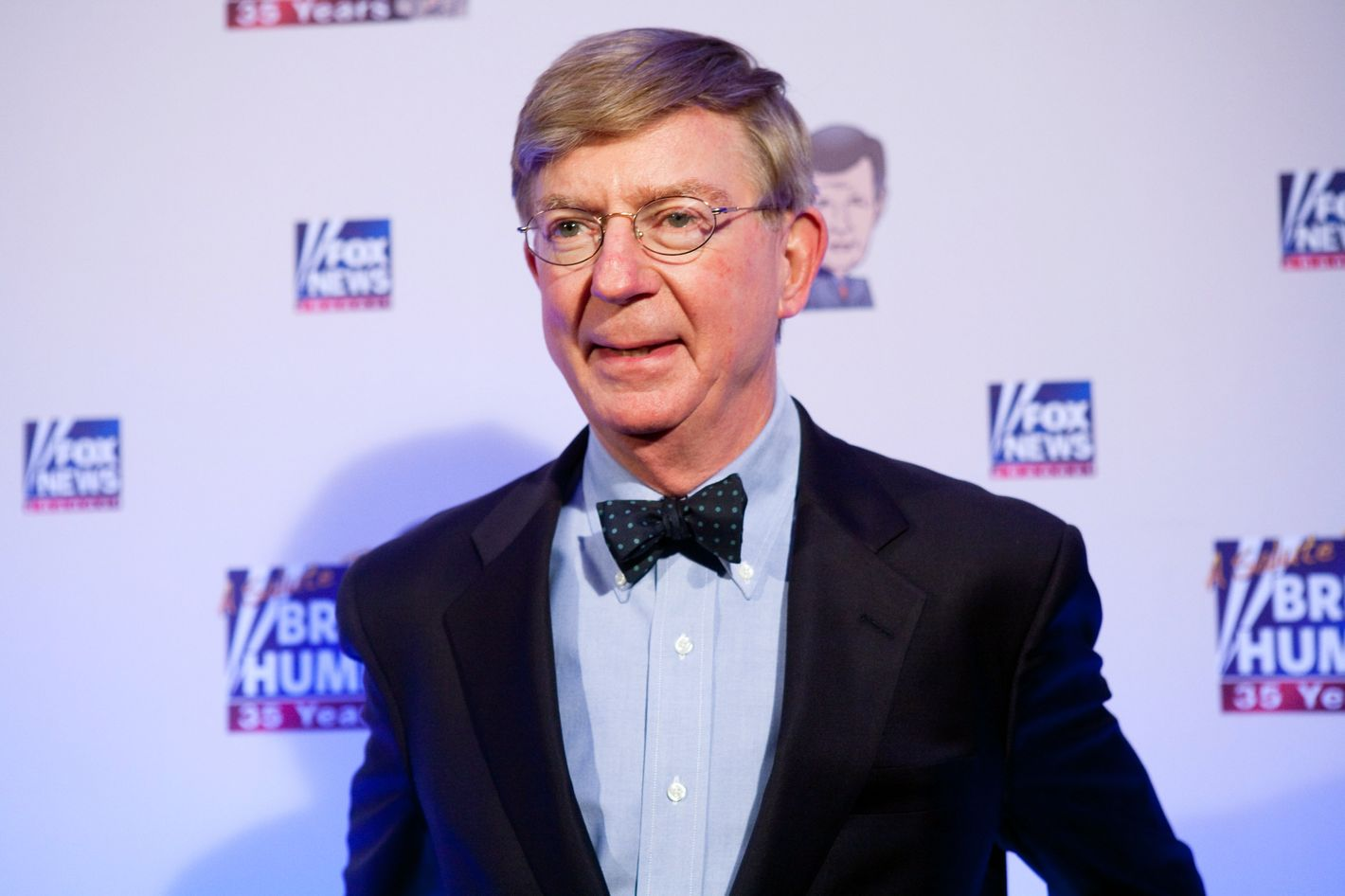 Conservative newspaper columnist George Will poses on the red carpet upon arrival at a salute to FOX News Channel's Brit Hume on January 8, 2009 in Washington, DC. Hume was honored for his 35 years in journalism.
