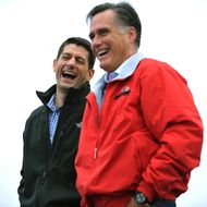 Republican presidential candidate Mitt Romney (R) and running-mate Paul Ryan share a laugh as they are introduced at a campaign rally September 25, 2012 at Dayton International Airport in Vandalia, Ohio.