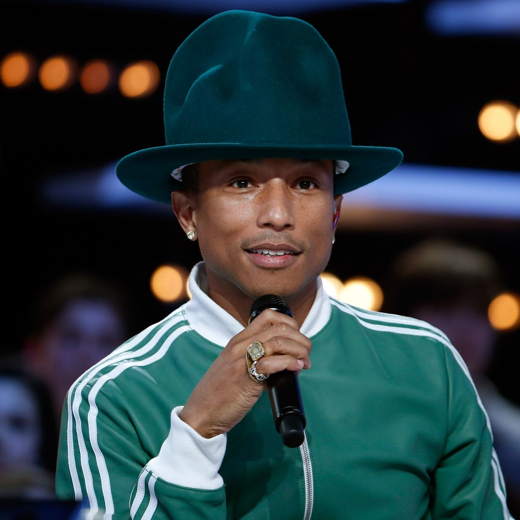 "US singer Pharrell Williams looks on as he takes part in the ""Le Grand Journal"" TV show at the headquarters of the French television channel Canal Plus in Paris, on February 24, 2014. AFP PHOTO / THOMAS SAMSON        (Photo credit should read THOMAS SAMSON/AFP/Getty Images)"