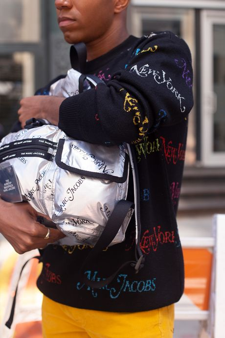New York Magazine® x Marc Jacobs The Logo Sweater, $495; The Ripstop Backpack, $250; The Turn Up Jean, $250; and The Jogger, $295