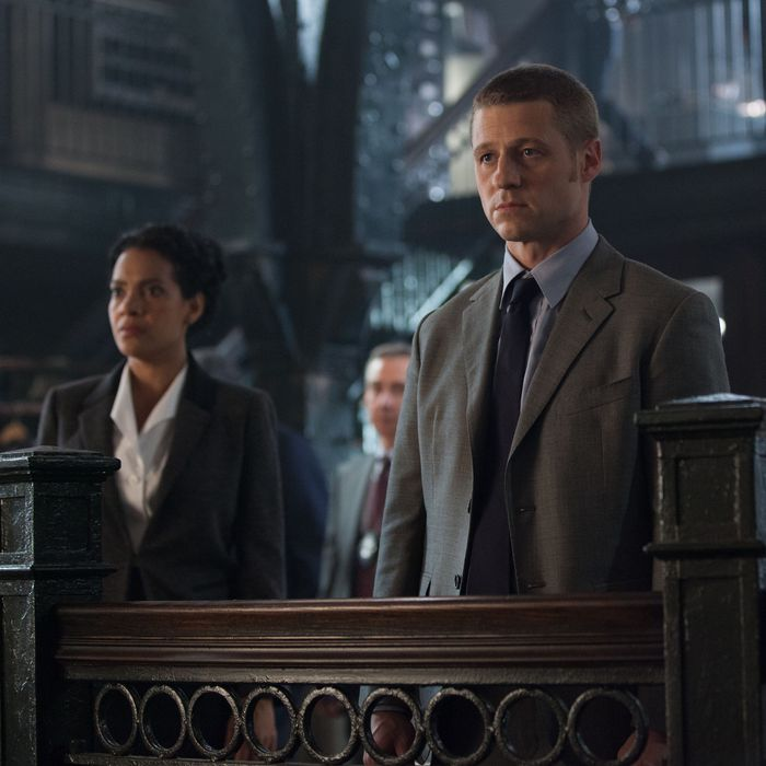 GOTHAM: An unwelcome visitor searches for Detective James Gordon (Ben McKenzie, R) at the GCPD in the