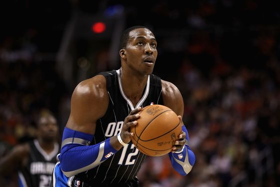 PHOENIX, AZ - MARCH 13:  Dwight Howard #12 of the Orlando Magic shoots a free throw shot during the NBA game against the Phoenix Suns at US Airways Center on March 13, 2011 in Phoenix, Arizona. The Magic defeated the Suns 111-88. NOTE TO USER: User expressly acknowledges and agrees that, by downloading and or using this photograph, User is consenting to the terms and conditions of the Getty Images License Agreement.  (Photo by Christian Petersen/Getty Images) *** Local Caption *** Dwight Howard