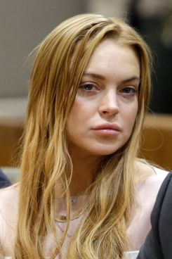 Actress Lindsay Lohan appear at a hearing in Los Angeles Superior Court on March 18, 2013 in Los Angeles, California. The hearing is to determine whether Lohan returns to jail or averts a trial on charges that she lied to police over a June, 2012 car crash that briefly sent her to the hospital. Lohan has pleaded not guilty to three misdemeanor charges filed after the accident - reckless driving, lying to police and obstructing officers from performing their duties.