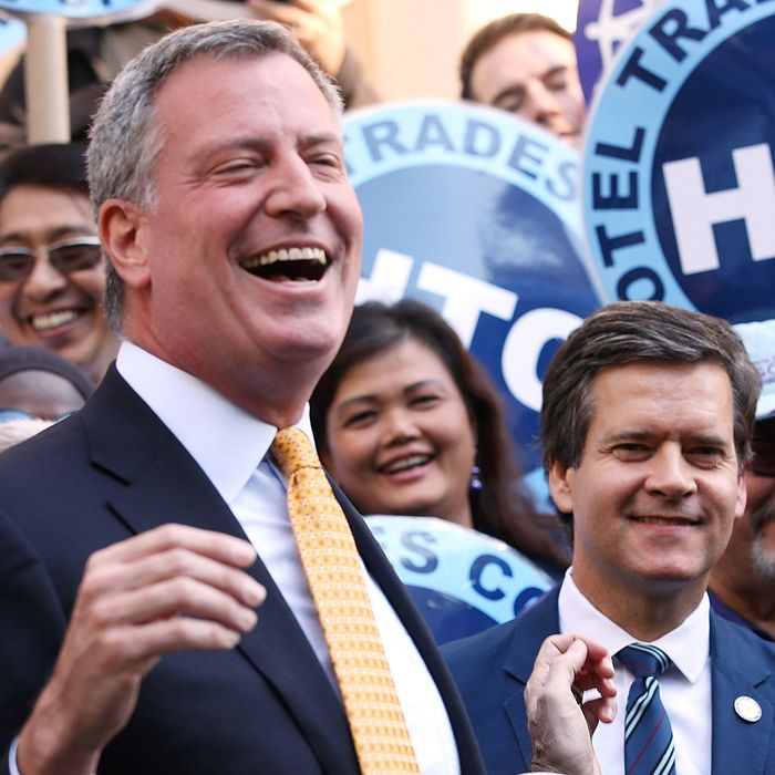 NEW YORK, NY - SEPTEMBER 17: Democratic mayoral nominee Bill de Blasio (L) laughs with Christine Quinn (2nd R), New York City Council Speaker and former mayoral hopeful, at a news conference where Quinn endorsed de Blasio outside City Hall on September 17, 2013 in New York City. De Blasio will face Republican Joseph Lhota in the general mayoral election November 5, 2013, with the winner succeeding current Mayor Michael Bloomberg. (Photo by Mario Tama/Getty Images)