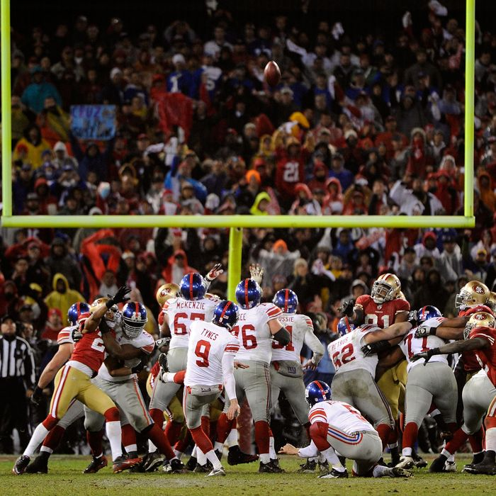 SAN FRANCISCO, CA - JANUARY 22: Lawrence Tynes #9 of the New York Giants kicks a successful 31-yard field goal in overtime against the San Francisco 49ers during the NFC Championship Game at Candlestick Park on January 22, 2012 in San Francisco, California. (Photo by Thearon W. Henderson/Getty Images)