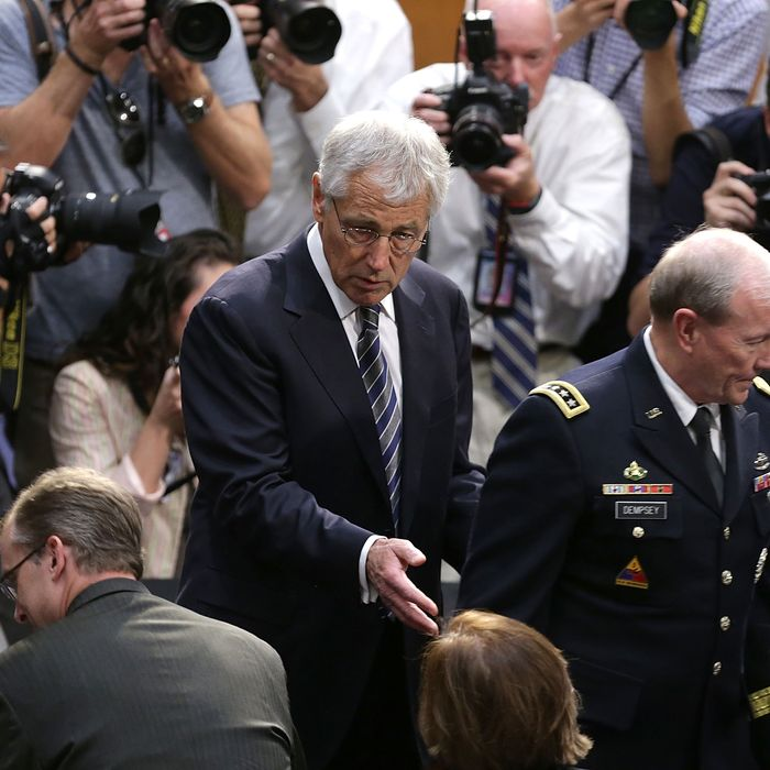 U.S. Defense Secretary Chuck Hagel (L) and Chairman of the Joint Chiefs of Staff Gen. Martin Dempsey (R) arrrive for testimony before the Senate Foreign Relations Committee on the topic of