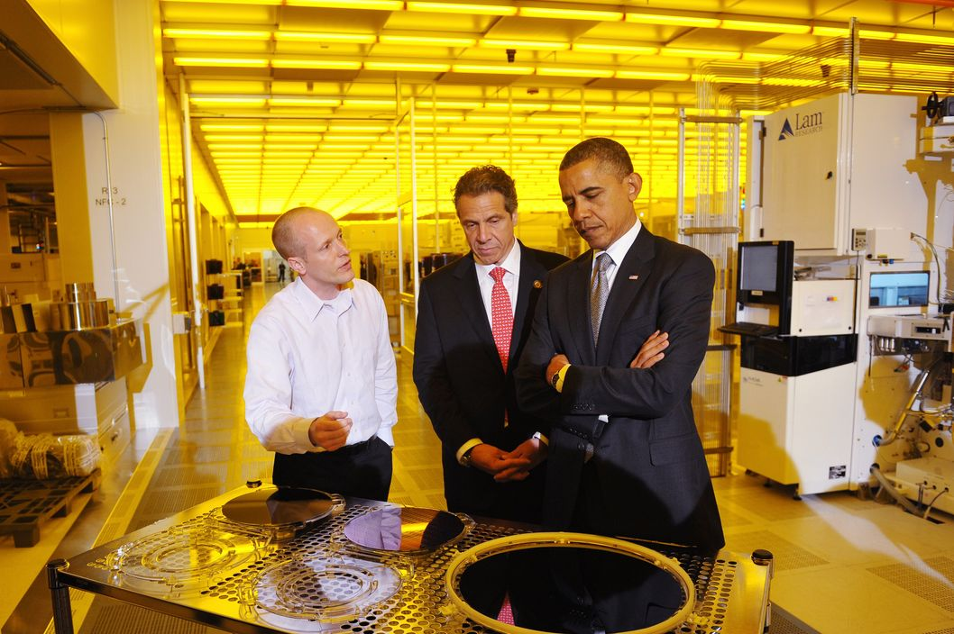 Obama and Cuomo stare at things. We won't say they're mundane things. But they are things.
