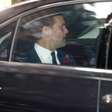 """News International chairman James Murdoch leaves in a car after a second hearing with a committee of British members of parliament into the on-going News of the World phone-hacking scandal in London on November 10, 2011.  James Murdoch rejected allegations on November 10 that he was a """"mafia boss"""" and told British lawmakers he had not misled them about the extent of his knowledge of phone-hacking at the News of the World.  AFP PHOTO / CARL COURT (Photo credit should read CARL COURT/AFP/Getty Images)"""