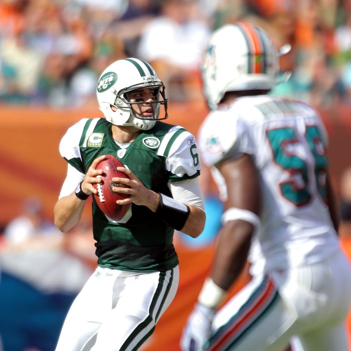 MIAMI GARDENS, FL - JANUARY 01: Quarterback Mark Sanchez #6 of the New York Jets throws against the Miami Dolphins at Sun Life Stadium on January 1, 2012 in Miami Gardens, Florida. (Photo by Marc Serota/Getty Images)