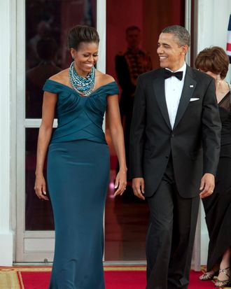 U.S. President Barack Obama, right, and first lady Michelle Obama walk to greet David Cameron, U.K. prime minister, and his wife Samantha Cameron on the North Portico of the White House in Washington, D.C., U.S., on Wednesday, March 14, 2012. Obama and Cameron showed a united front on finishing the war in Afghanistan and pressing for change in Iran and Syria, seeking to consolidate international support before a North Atlantic Treaty Organization meeting in May.