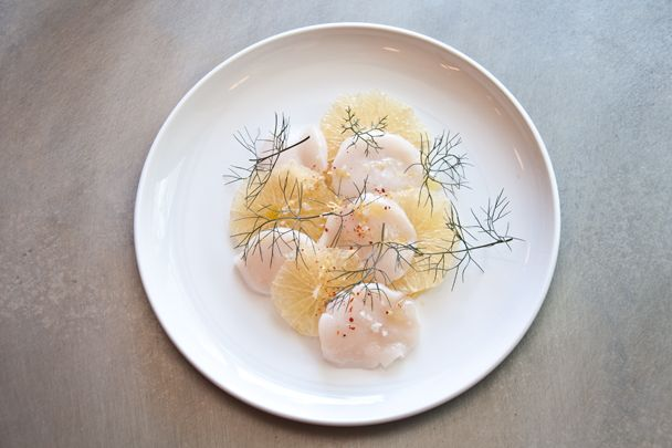 """The dish proves that inventiveness need not mean over-complication,"" Stein says of Estela's scallops."