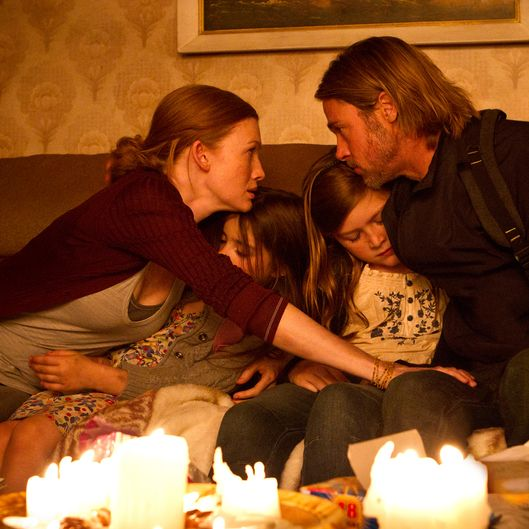Left to right: Mireille Enos is Karin Lane, Sterling Jerins is Constance Lane, Abigail Hargrove is Rachel Lane, and Brad Pitt is Gerry Lane in WORLD WAR Z, from Paramount Pictures and Skydance Productions in association with Hemisphere Media Capital and GK Films.WWZ-02386R