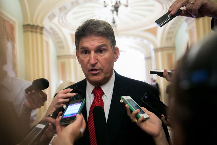 WASHINGTON, DC - SEPTEMBER 17: Sen. Joe Manchin (D-WV) talks to reporters before heading to a Senate Democratic policy luncheon, on Capitol Hill, September 17, 2013 in Washington, DC. Manchin discussed gun control issues with reporters in light of the Navy Yard shootings in Washington yesterday.  (Photo by Drew Angerer/Getty Images)
