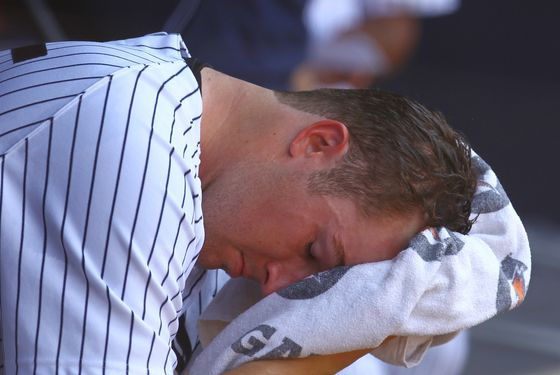 Phil Hughes #65 of the New York Yankees sits in the dugout after being removed from the game in the fifth inning against the Atlanta Braves during their game on June 20, 2012 at Yankee Stadium in the Bronx borough of New York City.