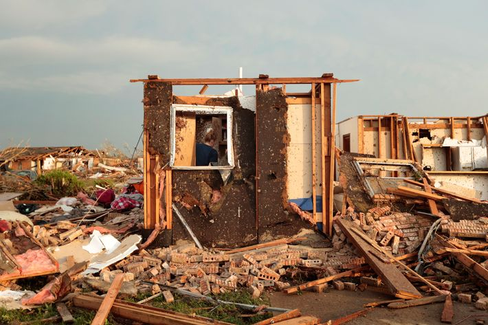 Dana Ulepich searches inside a room left standing at the back of her house destroyed after a powerful tornado ripped through the area on May 20, 2013 in Moore, Oklahoma. The tornado, reported to be at least EF4 strength and two miles wide, touched down in the Oklahoma City area on Monday killing at least 51 people.