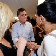 LAS VEGAS, NV - OCTOBER 17:  Former Massachusetts Gov. and Republican presidential hopeful Mitt Romney (C) greets supporters as he opens his Nevada campaign headquarters October 17, 2011 in Las Vegas, Nevada. Romney and six other presidential contenders will participate in a debate airing on CNN, sponsored by the Western Republican Leadership Conference in Las Vegas on October 18.  (Photo by Ethan Miller/Getty Images)