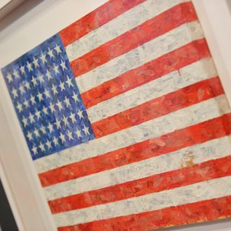 Jasper Johns' 'Flag', 1960-66, estimated at USD 10 million to 15 million, on display May 7, 2010 at Christie's in New York. The work belongs to the collection of Michael Chrichton, to be sold at the Post-War and Contemporary art evening sale at Christie's May 11. AFP PHOTO/Stan Honda (Photo credit should read STAN HONDA/AFP/Getty Images)