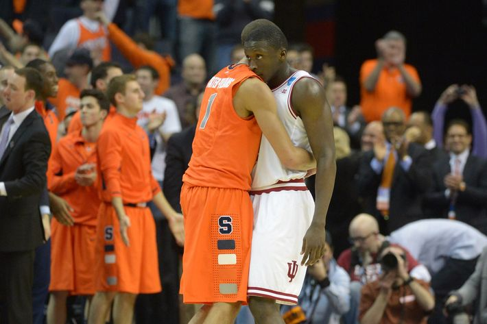 Syracuse guard Michael Carter-Williams (1) consoles Indiana Hoosiers guard Victor Oladipo (4) after Syracuse defeated Indiana 61-50 in game 2 of the NCAA east regional on March 28, 2013 in Washington, DC.