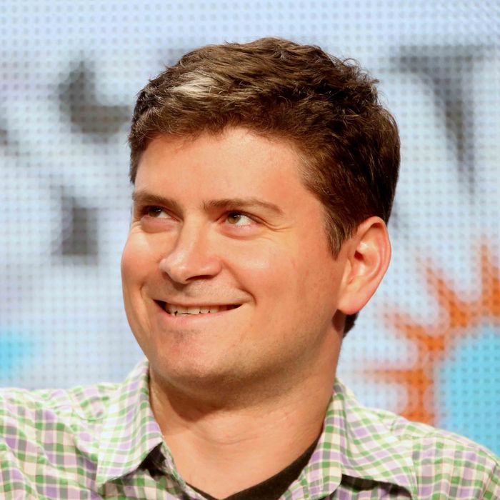 Michael Schur speaks onstage at the