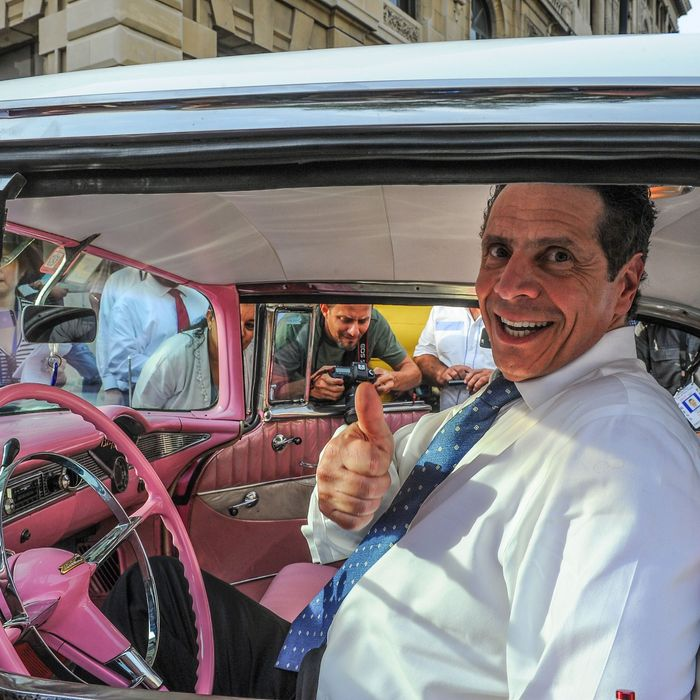 New York Governor Andrew Cuomo sits inside a vintage US car, on April 20, 2015. A delegation of the US state of New York, led by Democrat Governor Cuomo, arrived in Cuba as talks between the two countries continue on trying to re-establish diplomatic ties which have been frozen for five decades. AFP PHOTO /Yamil LAGE (Photo credit should read YAMIL LAGE/AFP/Getty Images)