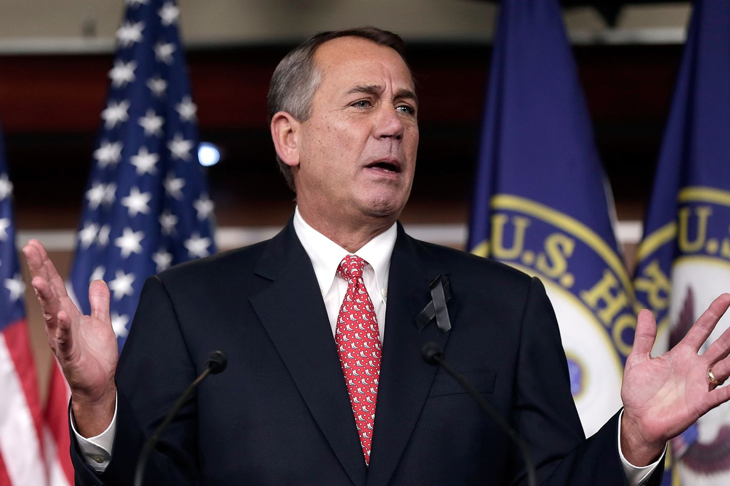 "WASHINGTON, DC - DECEMBER 12:  U.S. Speaker of the House John Boehner (R-OH) answers questions during a press conference December 12, 2013 in Washington, DC. When asked during the press conference if he would press ultra-conservative groups to tone down their criticism of a pending budget deal, Boehner said ""I don't care what they do.""  (Photo by Win McNamee/Getty Images)"