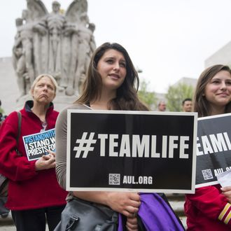Anti-abortion demonstrators hold signs during a Priests for Life protest outside the US Court of Appeals for the DC Circuit Court as the Court hears the oral arguments in the