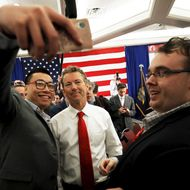 Republican presidential candidate U.S. Senator Rand Paul poses for a selfie with an audience member after speaking at the First in the Nation Republican Leadership Conference in Nashua