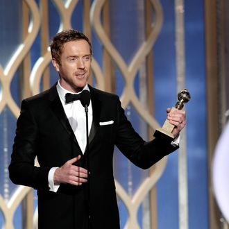 In this handout photo provided by NBCUniversal, Actor Damian Lewis accepts the best actor award for TV Series, Drama,