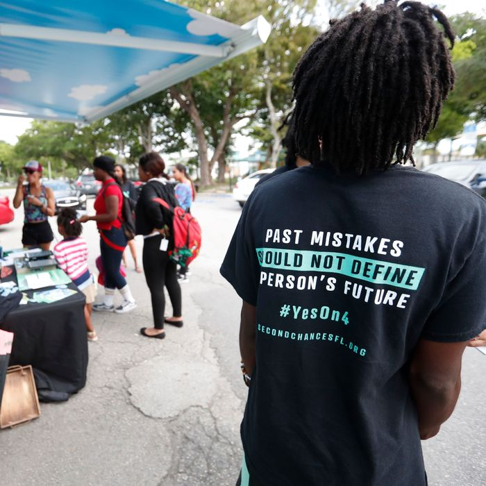 """People gather around the Ben & Jerry's """"Yes on 4"""" truck as they learn about Amendment 4 and eat free ice cream at Charles Hadley Park in Miami on October 22, 2018."""